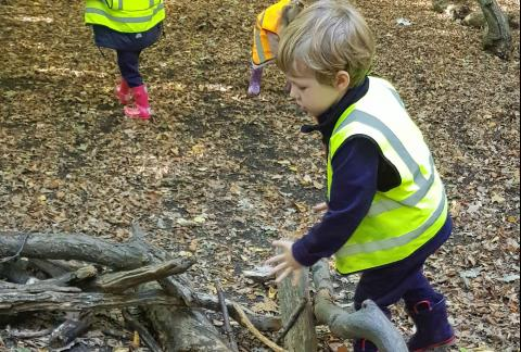 Making a giant bird's nest at Forest School