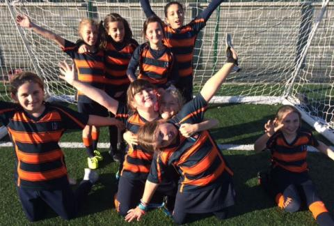 Senior Prep Girls and Boys on the Football pitch